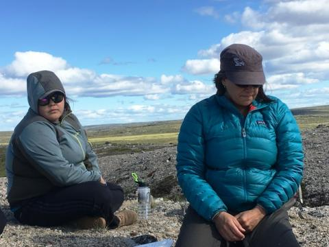 Resting on the tundra.  TSSRAP student Allison Wetrade on the left.  Photo: GNWT / T.Stephenson, ENR