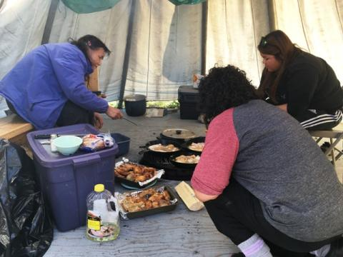 TSSRAP student Allison Wetrade helping out with cooking during Tundra Science and Culture Camp.  Photo:  GNWT / T.Stephenson, ENR