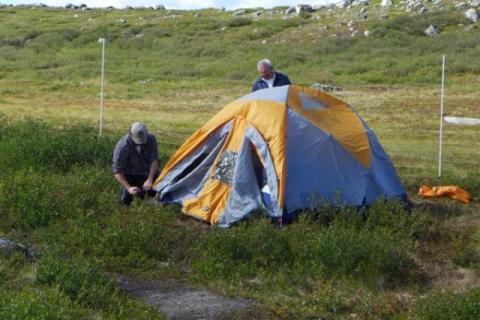 Boyan Tracz, Wildlife Management Biologist, WRRB; and James Rabesca setting up tents