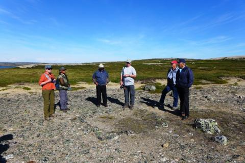 Board members and staff looking at tent ring on Barren-lands.  Photo:  Jody Pellissey, WRRB