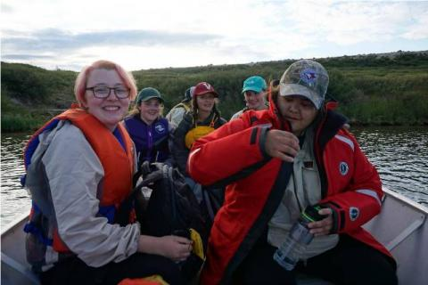 TSSRAP student Allison Wetrade with Tundra Science and Culture Camp students. Photo:  GNWT / K. Clark, ENR