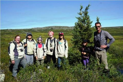 Checking out rare tree growth on the tundra.  Photo: GNWT / K.Clark, ENR