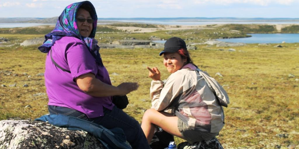 TSSRAP summer student Teya Wetrade learning from elder Rita Wetrade at Science and Culture Camp. Photo © GNWT / Stephanie Yuill